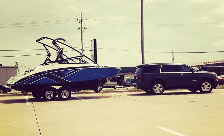 photo of boat and car purcchased after successful credit repair